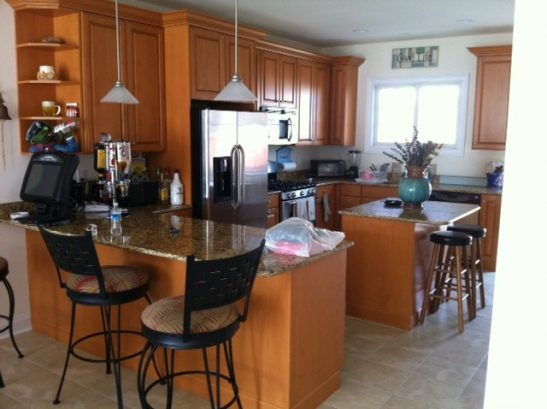 kitchen fully equipped. bar. tile floors. leads to back deck wi