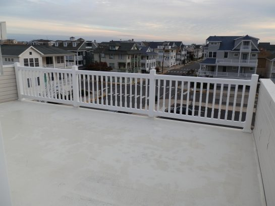 Huge rooftop deck with plenty of chairs and chaise lounges---and fabulous ocean views