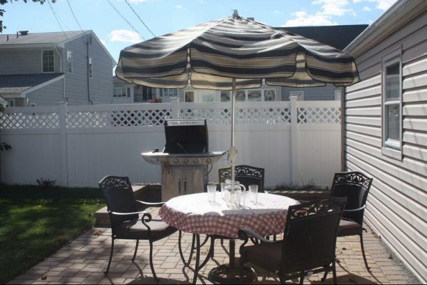 Backyard Paver Patio with Table & Barbecue Grill