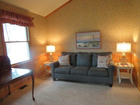 Upper level den has queen sleeper couch