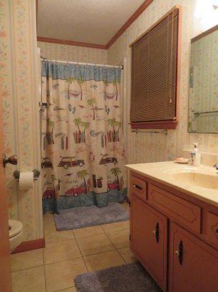 Upper level bathroom off master bedroom has shower