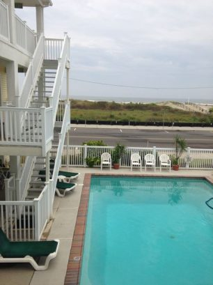 View Of Heated Pool. Plenty of pool furniture.
