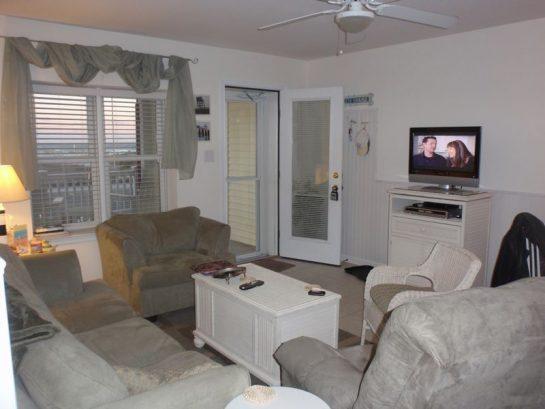 Casual Living area. Enjoy view of ocean thru open storm door.