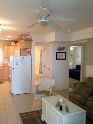 View from living area of kitchen, bathroom, second bedroom.