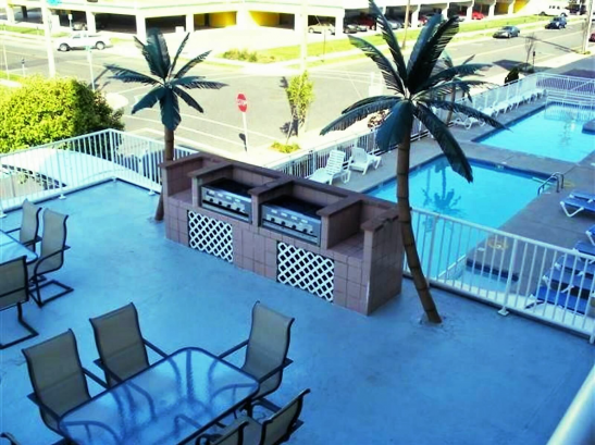 Patio overlooking two heated pools and a smaller pool for the kids to enjoy as well!