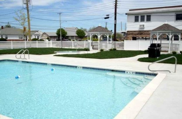 20X34 HEATED HIALEAH COMMUNITY POOL WITH OUTDOOR SHOWERS,LOUNGE CHAIRS, SEATING/SHADE, AND CABANA ROOM