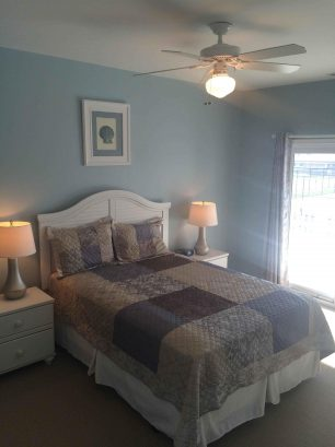 LARGE QUEEN MASTER BEDROOM WITH ADJOINING PRIVATE BATHROOM & SLIDER TO BALCONY WITH NEW TOP OF THE LINE MATTRESS