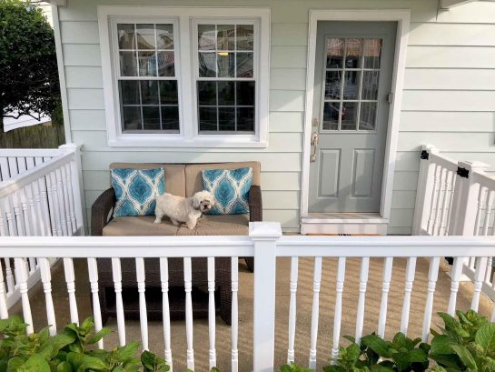 Front porch with latching gate.