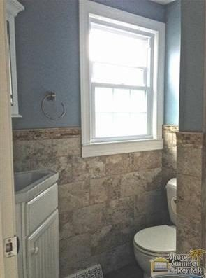 Main floor Bathroom With Small Walk-in Shower