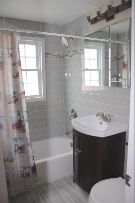 Main floor bathroom with tub/shower combo