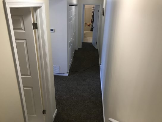 Unit 7 hallway with laundry room