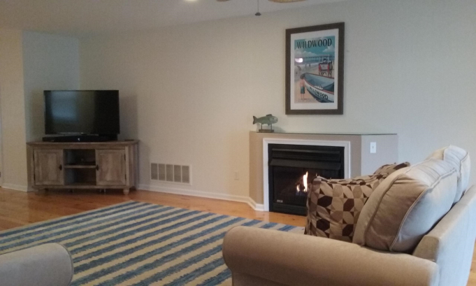Family room with large TV and sound base
