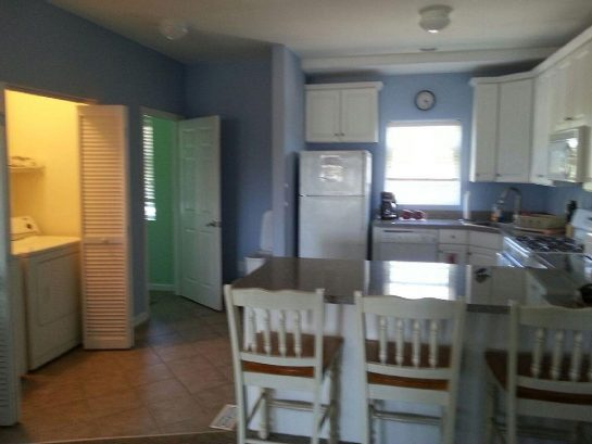 Full eat-in kitchen with easy access to washer/dryer and powder room.