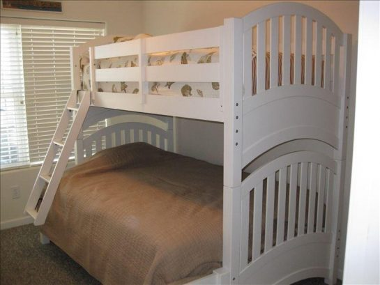 Bedroom with bunk beds and large walk-in closet. Great for kids!