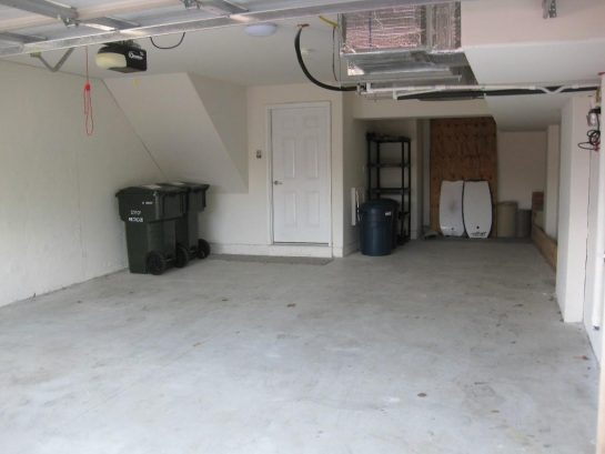 Garage can comfortably accommodate 2 mid-sized vehicles.
