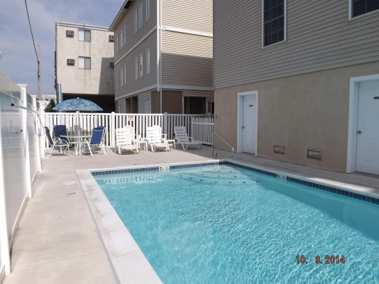 crystal clear heated pool, professionally maintained