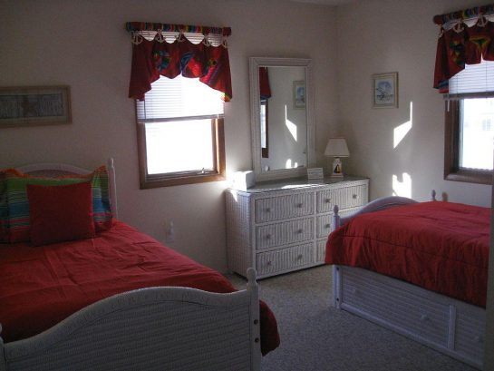First floor twin bed bedroom with a trundle bed.