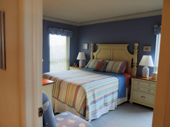second bedroom with queen sized bed