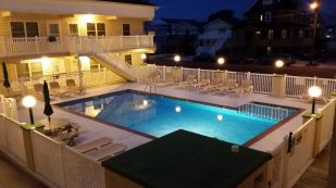1 Large bedroom, 1 Bath - 2 pools(1 heated), gas grills, close to everything