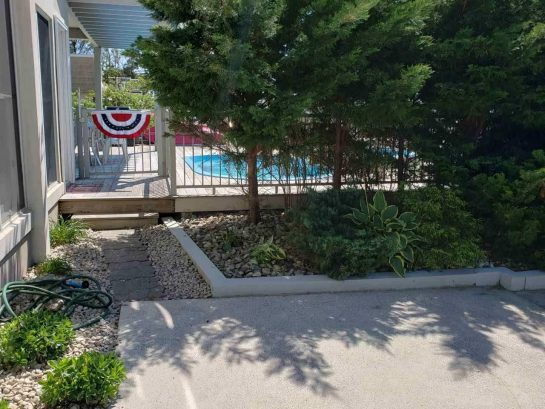 Walkway to Back Door and Pool. Fence Around Pool. Can Be Locked