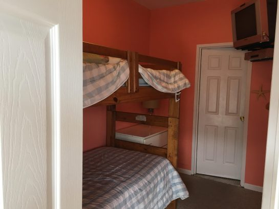 The second bedroom has bunkbeds.