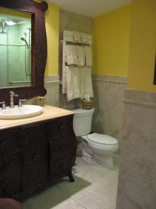 Elegant tiled bathroom with large storage vanity