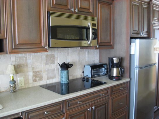 Kitchen with cook top and combination microwave/convection oven.