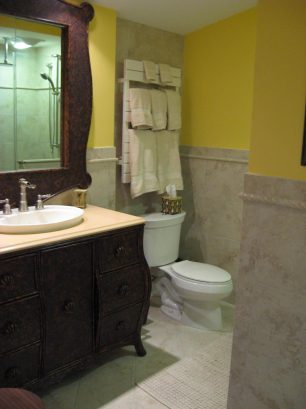 Spa like bathroom, large storage vanity, heated towel rack, over sized shower