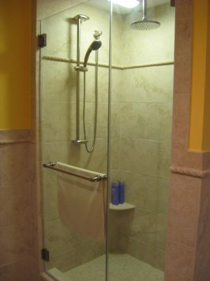Over sized shower, with 3 shower heads (one adjustable, and one not shown)
