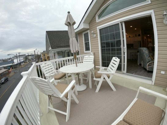 Airy and open front deck.  Great view.