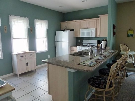 Fully-stocked kitchen with granite breakfast bar