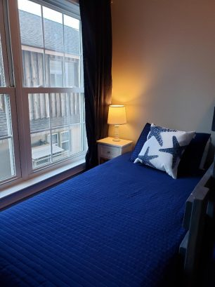 View of bunk room with the twin bed by the window.