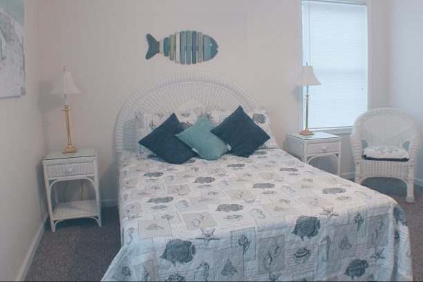 Bedroom on second floor has a queen bed.