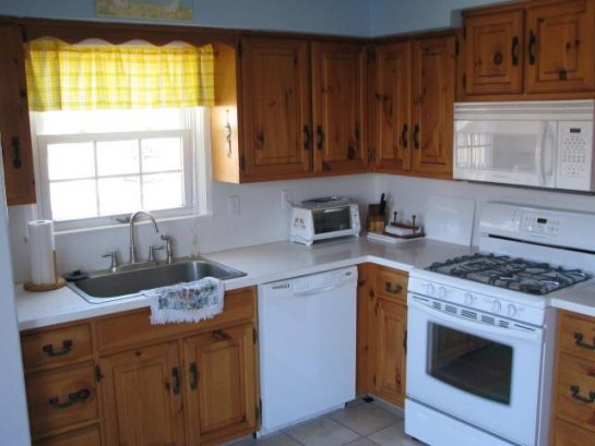 Kitchen with garbage disposal, dishwasher, toaster oven, microwave, oven