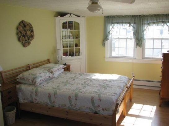 Upstairs master  with queen bed, dressers, closets