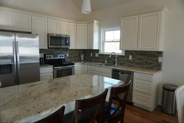 Kitchen - granite countertops and stainless steel appliances