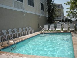 Luxury Top Floor Condo - Pool, Elevator, OceanView, 1 Block to Beach & Boardwalk