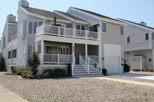 ONLY 1.5 BLOCKS FROM THE BEACH, NEWLY RENOVATED TOWNHOME WITH BAY, WETLAND & SUNSET VIEWS