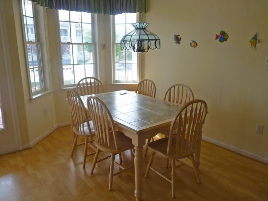 Beautiful, tiled dining room table with 8 chairs
