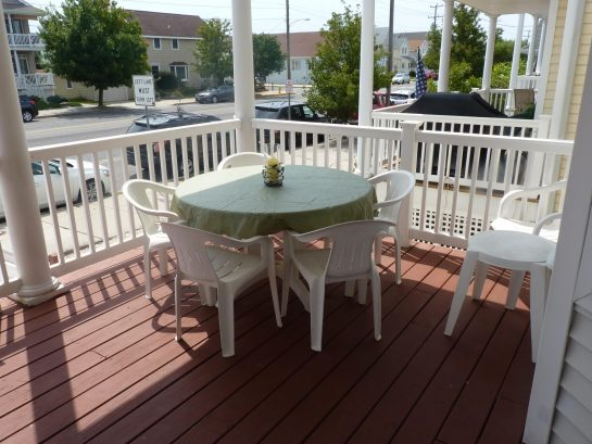 Outdoor dining for 10 on covered front porch
