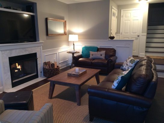 """1st Floor Living Room - Leather Couch & Love Seat, fireplace and 60"""" TV"""