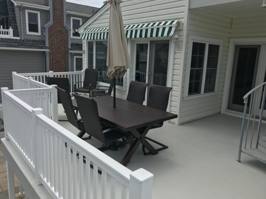 2nd Floor - Large Rear Deck ( 15ft x 28ft) with retractable awning, ocean views and large dining table
