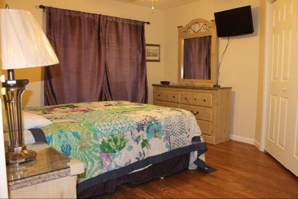 Master Bedroom-Queen Bed w/Headboard, Two Night Tables Dresser w/Mirror, Hardwood Floors