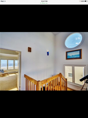 14 Ft. Ceilings with Large Windows in Staircase