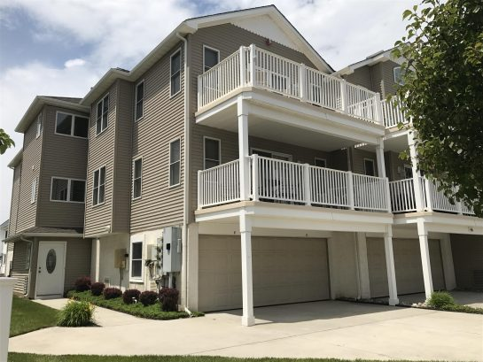 3 car garage parking and 4th car in driveway, end unit with hot outdoor showers in the rear of condo