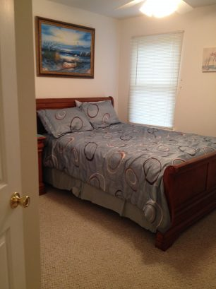 Guest bedroom with queen size bed , dresser and spacious closet