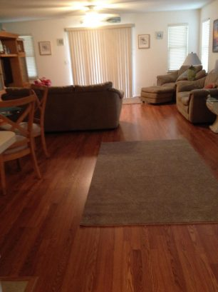Spacious open floor plan, with new pergo flooring and area rugs