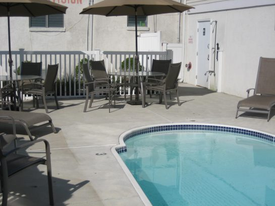 Large private heated pool and patio with bath facilities