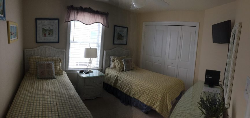 """The third bedroom contains two twin beds and a 25"""" wall mounted flat-panel HD Smart TV"""