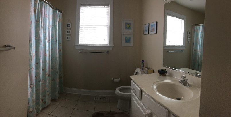 The second bathroom is large and includes a full size tub.